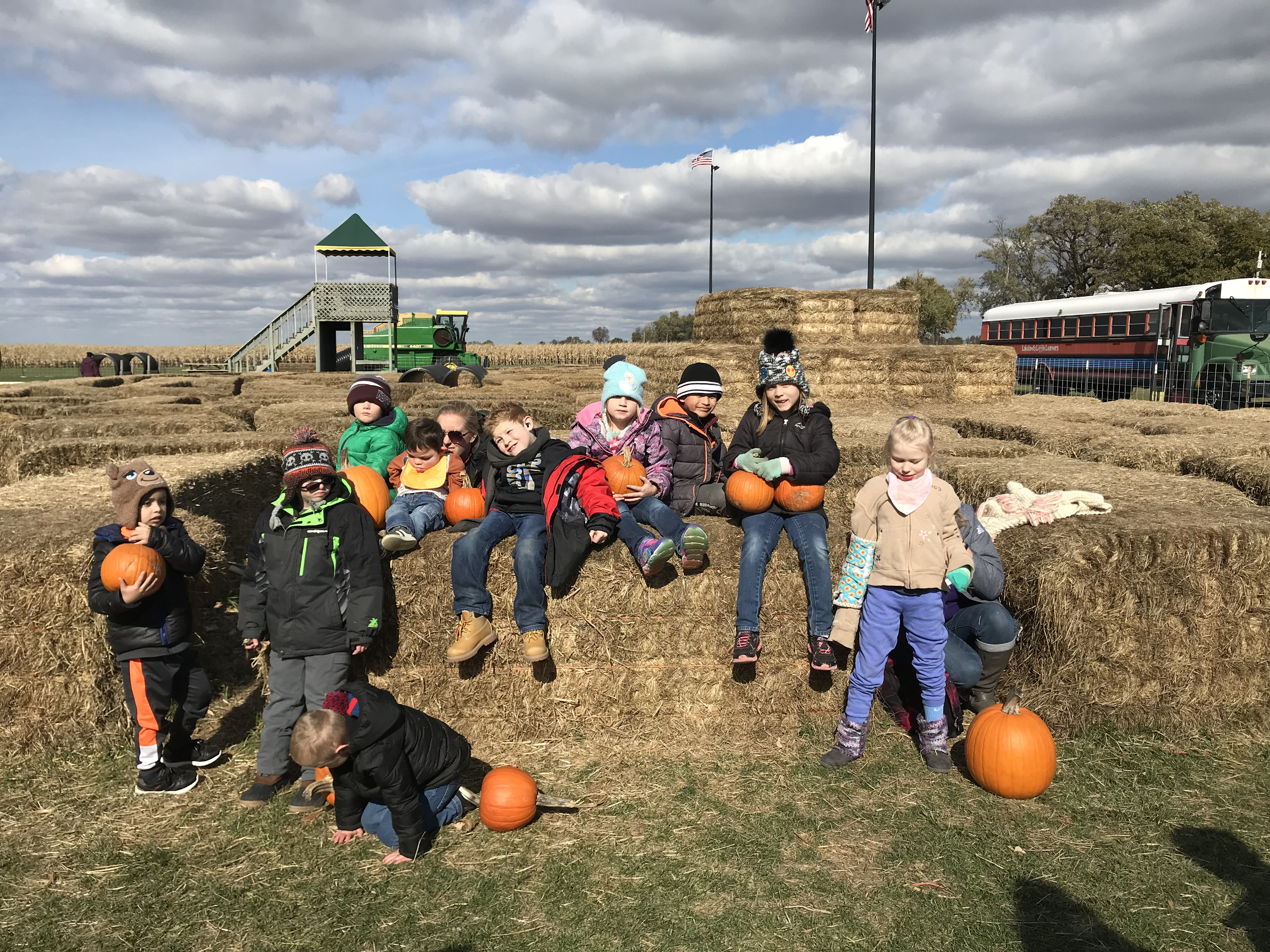 Group of kids holding pumpkins
